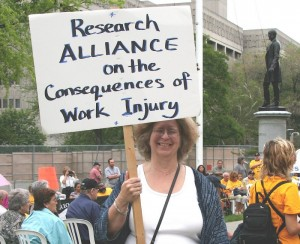 RAACWI banner at Injured Workers Day