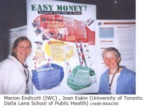 "Marion Endicott & Joan Eakin beside poster of ""easy Money"" project"