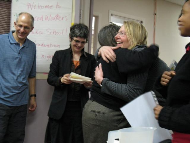 Graduate receives congratulatory hug