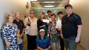 Injured workers from the Bright Lights Group deliver a letter to the Ombudsman