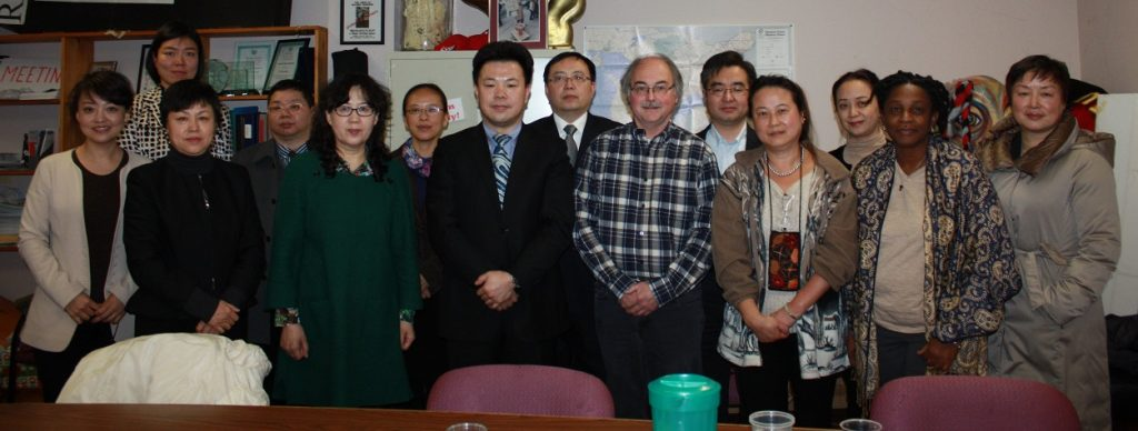Chinese delegation at Injured Workers Consultants clinic.  delegation with Deputy Director Yufei, centre, and to the right IWC staff John McKinnon, Rebecca Lok and Audrey Parkes