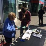 Public signing petition outside Pape subway
